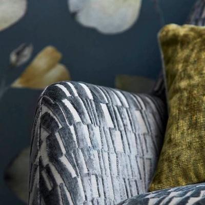 Grey block chair with green cushion