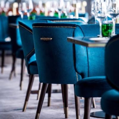 Blue velvet chairs in restaurant