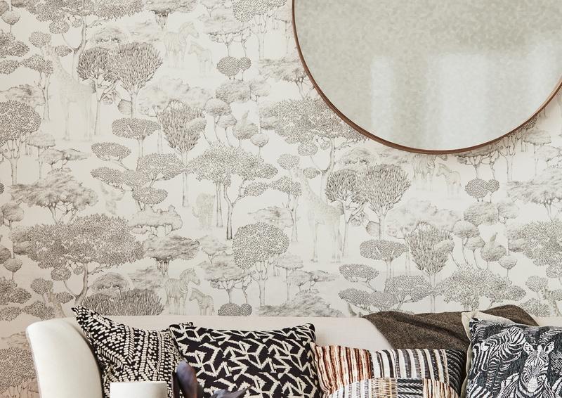 Black and White woodland scene wallpaper in living room