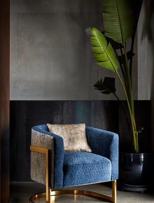 Blue and gold chair with golden cushion