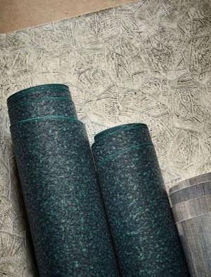 Blue textured wallpaper roll