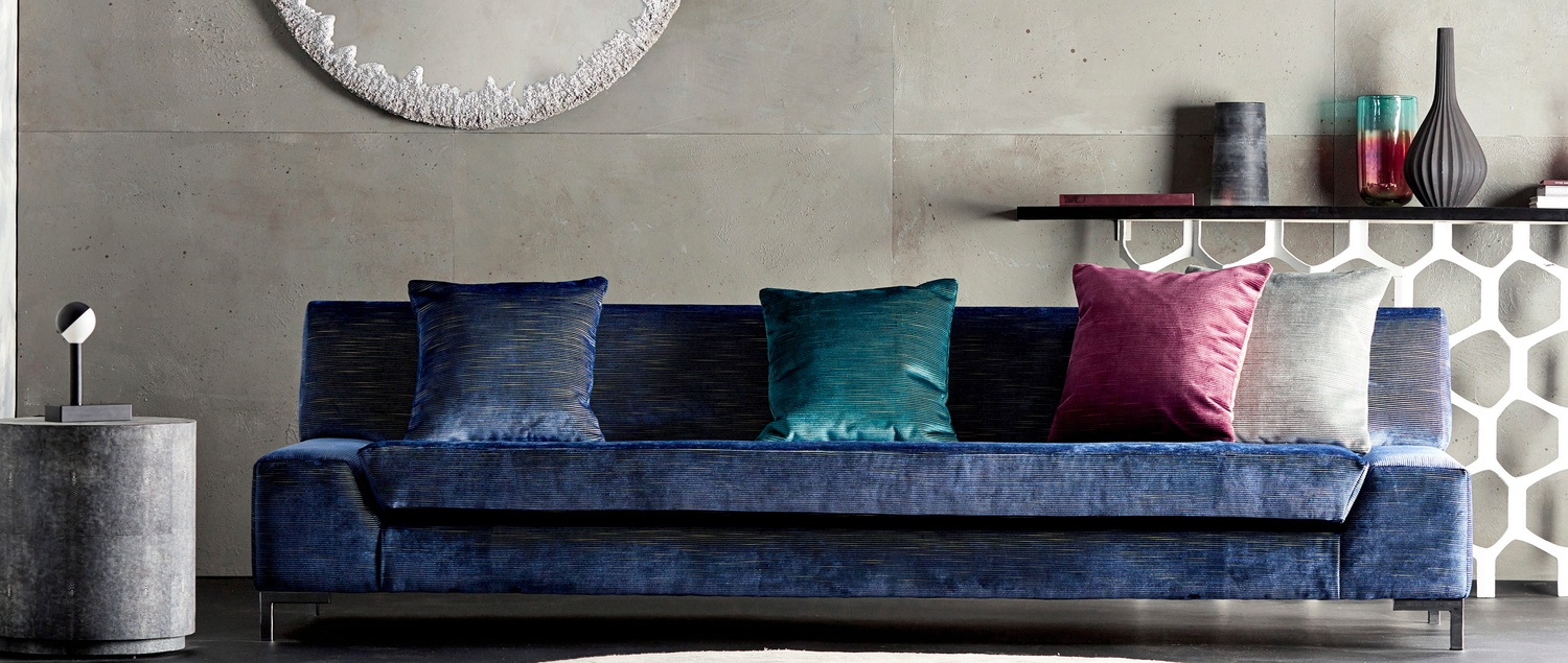 Hibiki Blue velvet sofa with pink and blue cushions
