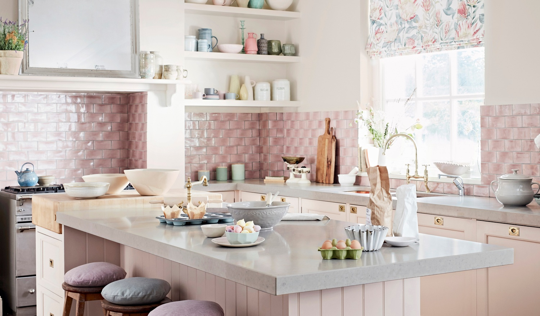 Light pink tiled kitchen splashback and white island unit