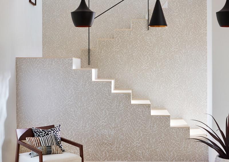 Harlequin neutral white wallpaper on staircase