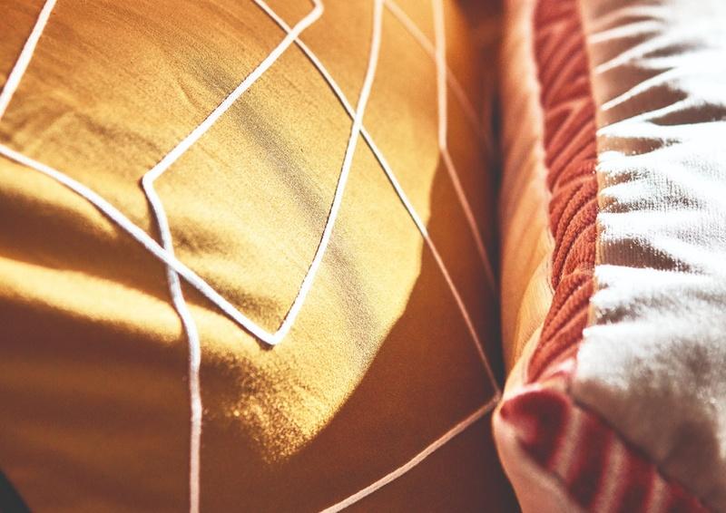 Momentum 13 14 yellow fabric on cushion