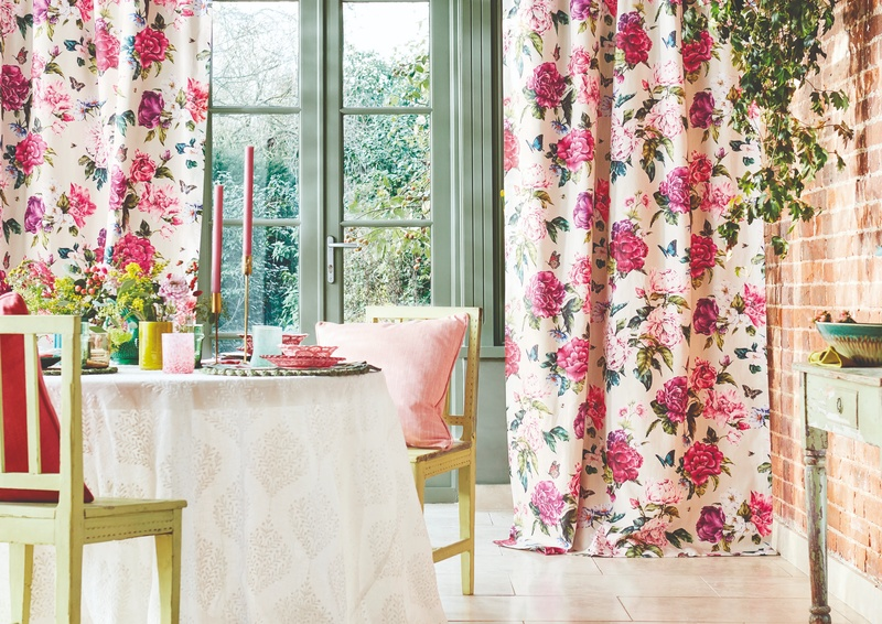 Pink and white floral curtains in dining area