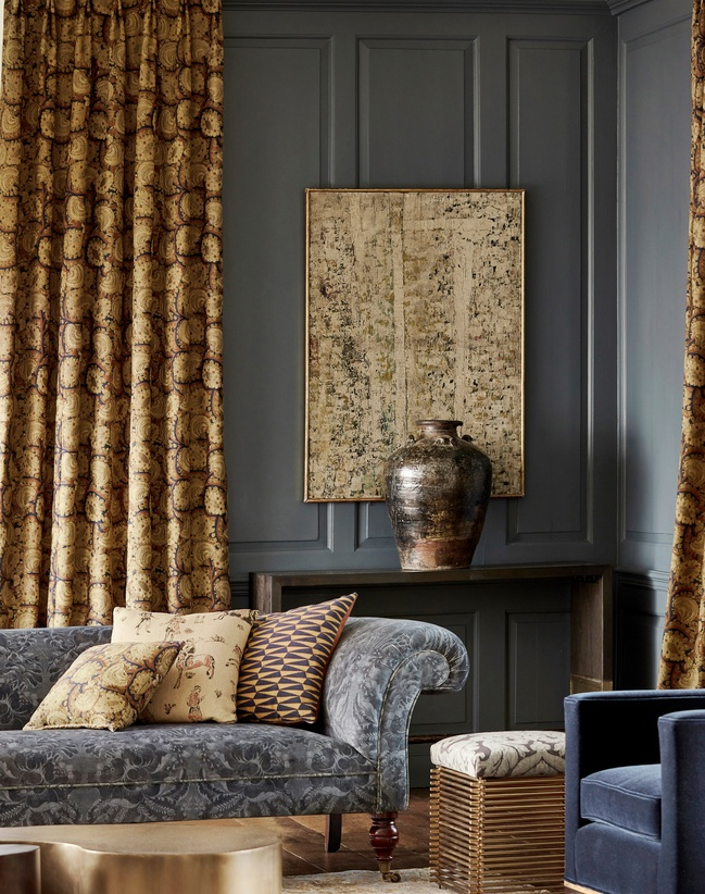 Brown and grey interiors cushion, sofa and curtains in lounge